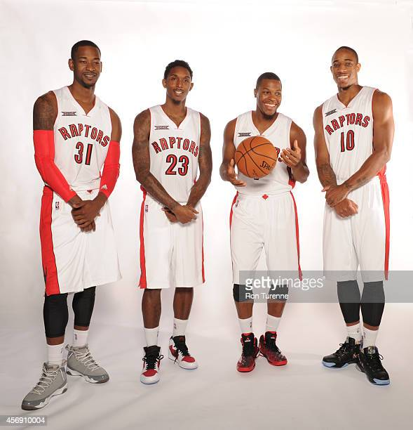 Terrence Ross Louis Williams Kyle Lowry and DeMar DeRozan of the Toronto Raptors poses for a photo during Media Day September 29 2014 at the Air...