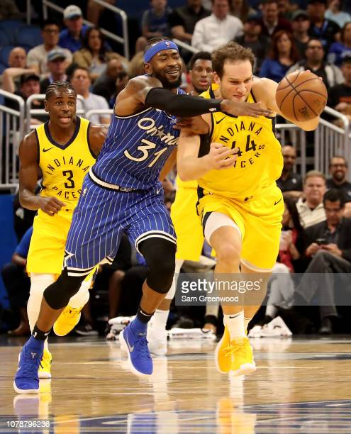 Terrence Ross of the Orlando Magic and Bojan Bogdanovic of the Indiana Pacers battle for a loose ball during the game at Amway Center on December 07...