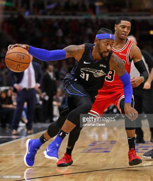 Terrence Ross of the Orlando Magic drives around Shaquille Harrison of the Chicago Bulls at United Center on December 21 2018 in Chicago Illinois...
