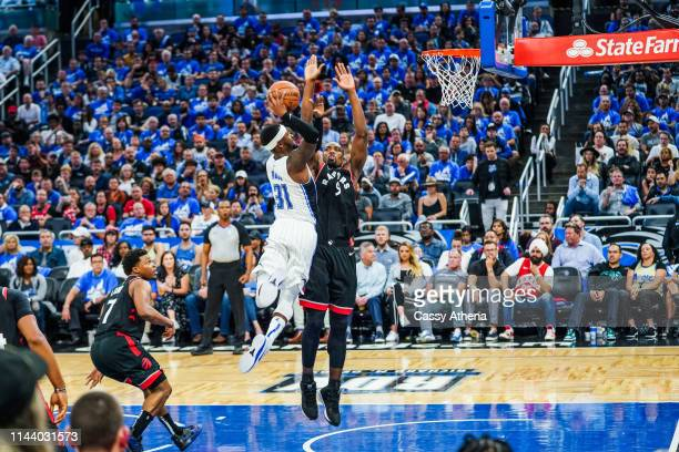 Terrence Ross of the Orlando Magic dunks the ball over Serge Ibaka of the Toronto Raptors during a game at Amway Center on April 19 2019 in Orlando...