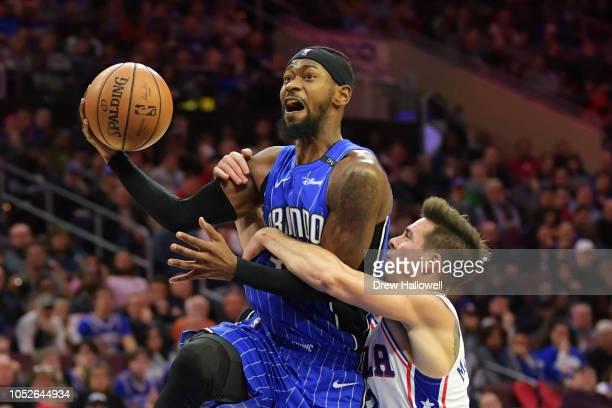 Terrence Ross of the Orlando Magic gets fouled by TJ McConnell of the Philadelphia 76ers at Wells Fargo Center on October 20 2018 in Philadelphia...