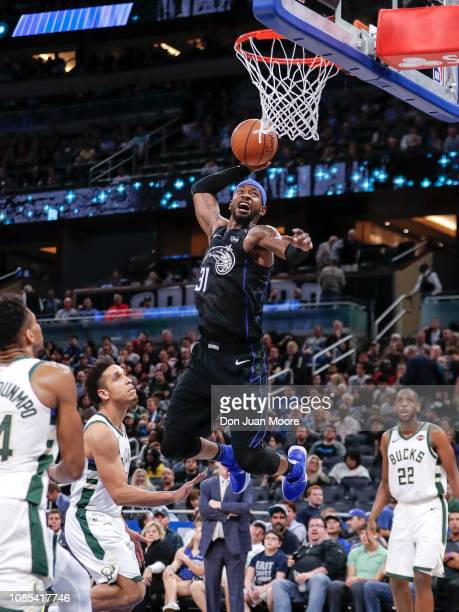 Terrence Ross of the Orlando Magic goes up for a dunk over Giannis Antetokounmpo and Malcom Brogdon of the Milwaukee Bucks during the game at the...