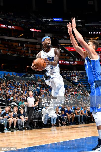 Terrence Ross of the Orlando Magic looks to pass against the Dallas Mavericks during a preseason game on October 5 2017 at Amway Center in Orlando...