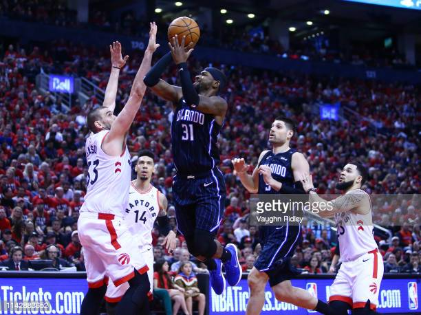 Terrence Ross of the Orlando Magic shoots the ball as Marc Gasol of the Toronto Raptors defends during Game One of the first round of the 2019 NBA...