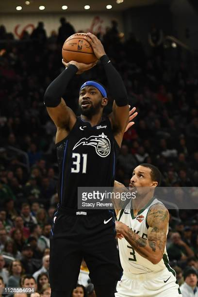 Terrence Ross of the Orlando Magic takes a shot in front of George Hill of the Milwaukee Bucks during the second half of a game at Fiserv Forum on...