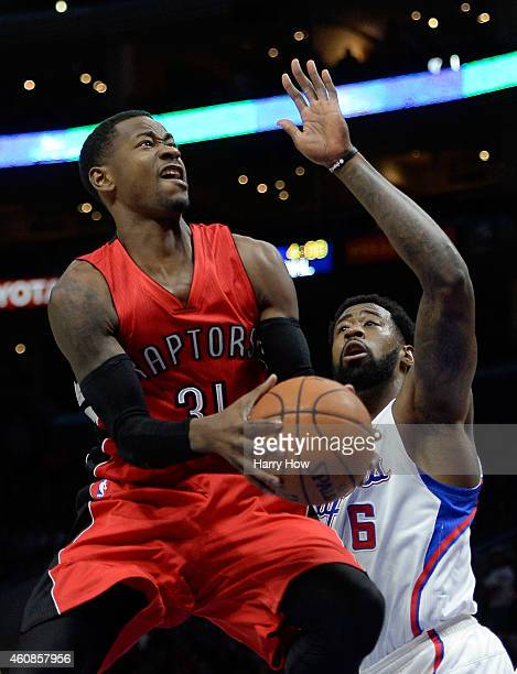 Terrence Ross of the Toronto Raptors attempts a shot in front of DeAndre Jordan of the Los Angeles Clippers during the first half at Staples Center...