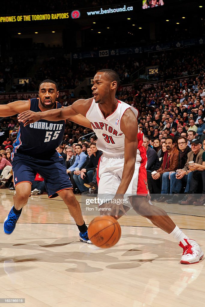 Terrence Ross #31 of the Toronto Raptors drives against Reggie Williams #55 of the Charlotte Bobcats on March 15, 2013 at the Air Canada Centre in Toronto, Ontario, Canada.