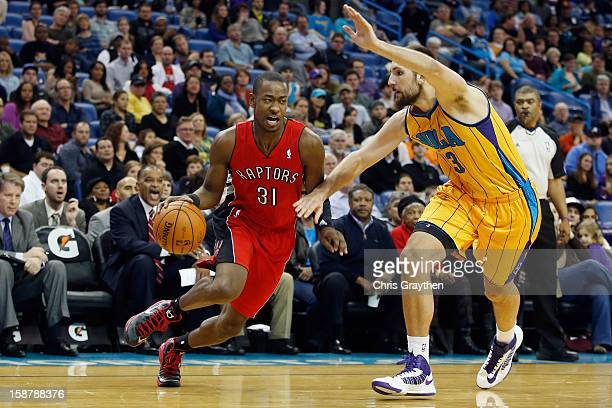Terrence Ross of the Toronto Raptors drives the ball around Ryan Anderson of the New Orleans Hornets at New Orleans Arena on December 28 2012 in New...