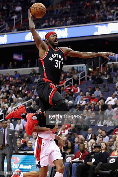 Terrence Ross of the Toronto Raptors dunks over Kelly Oubre Jr #12 of the Washington Wizards in the first half at Verizon Center on November 2 2016...