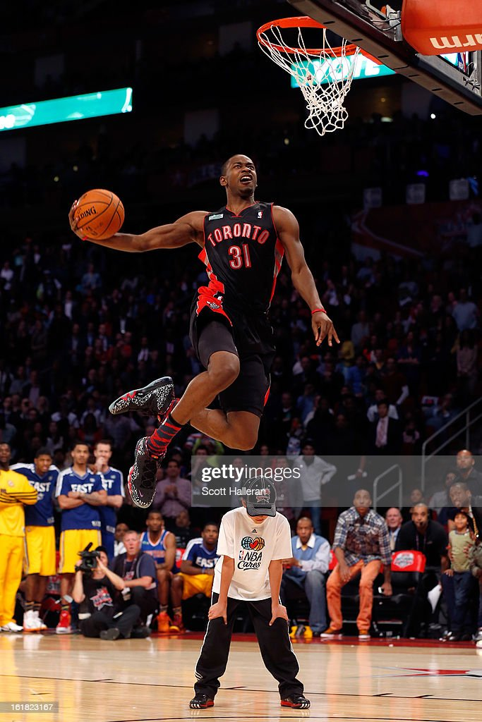 Terrence Ross of the Toronto Raptors jumps over a ball kid in his final dunk during the Sprite Slam Dunk Contest part of 2013 NBA All-Star Weekend at the Toyota Center on February 16, 2013 in Houston, Texas.
