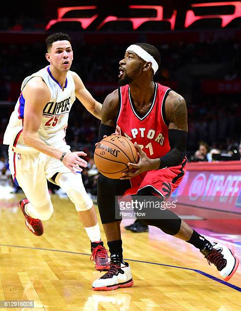 Terrence Ross of the Toronto Raptors prepares to shoot as he is chased down by Austin Rivers of the Los Angeles Clippers during a preseason game at...