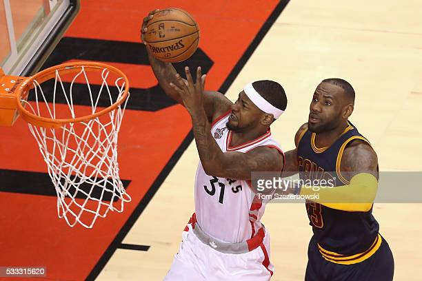 Terrence Ross of the Toronto Raptors shoots the ball against LeBron James of the Cleveland Cavaliers during the first half in game three of the...