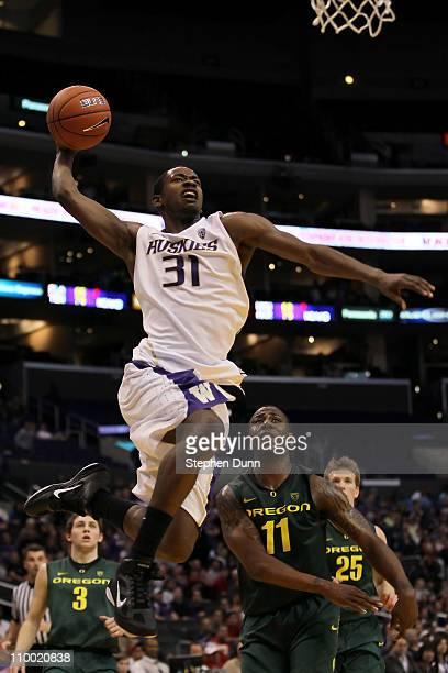 Terrence Ross of the Washington Huskies goes up for a dunk late in the second half while taking on the Oregon Ducks in the semifinals of the 2011...