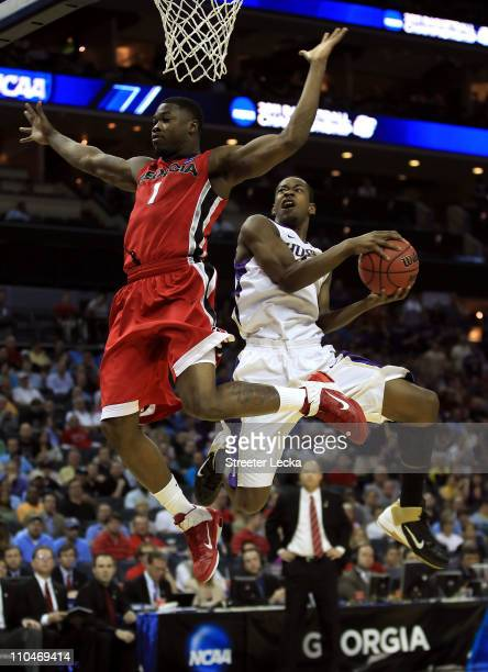 Terrence Ross of the Washington Huskies goes up for a shot against Travis Leslie of the Georgia Bulldogs in the first half during the second round of...