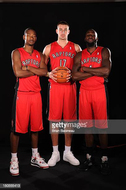 Terrence Ross Quincy Acy and Jonas Valanciunas of the Toronto Raptors poses for a portrait during the 2012 NBA rookie photo shoot on August 21 2012...