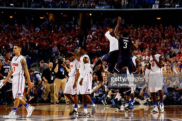 Terrence Samuel and the Connecticut Huskies celebrate after defeating the Florida Gators 63-53 in the NCAA Men's Final Four Semifinal at AT&T Stadium...