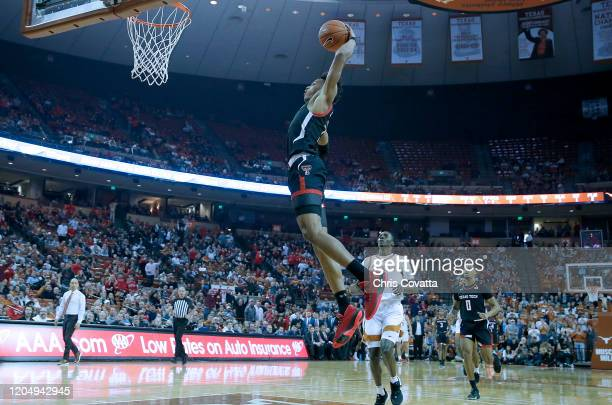 Terrence Shannon Jr. #1 of the Texas Tech Red Raiders slam dunks in front of Andrew Jones of the Texas Longhorns at The Frank Erwin Center on...