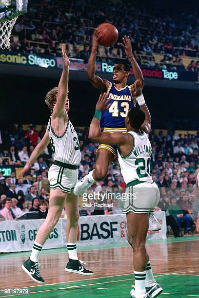 Terrence Stansbury of the Indiana Pacers goes up for a shot againt Larry Bird and Ray Williams of the Indiana Pacers during a game played in 1985 at...