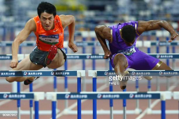Terrence Trammell of the United States and Liu Xiang of China compete during the men's 110m Hurdles during the 2009 Shanghai Golden Grand Prix at...