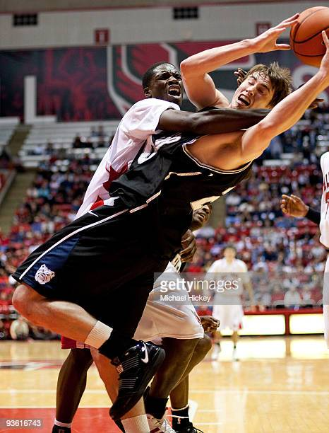 Terrence Watson of the Ball State Cardinals fouls Gordon Haywood of the Butler Bulldogs for a rebound during action at John E Worthen Arena at on...