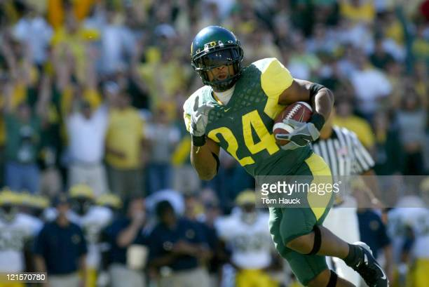 Terrence Whitehead of the Oregon Ducks runs for a touchdown against the Michigan Wolverines at Autzen Stadium in Eugene Oregon Oregon defeated...
