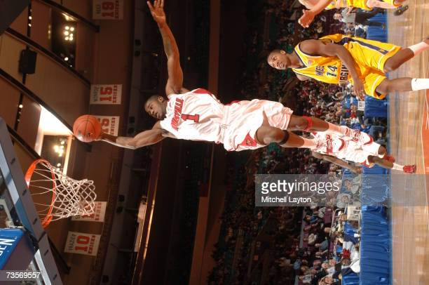 Terrence Williams of Louisville Cardinals goes to the basket during a game against the West Virginia Montaineers in the Big East College Basketball...