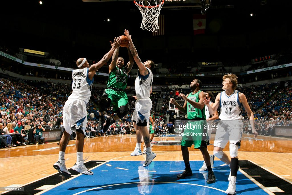 Terrence Williams #55 of the Boston Celtics drives to the basket against Dante Cunningham #33 and Nikola Pekovic #14 of the Minnesota Timberwolves on April 1, 2013 at Target Center in Minneapolis, Minnesota.