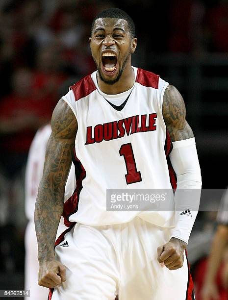 Terrence Williams of the Louisville Cardinals celebrates during overtime of the Big East Conference game against the Notre Dame Fighting Irish on...