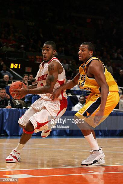 Terrence Williams of the Louisville Cardinals goes to the hoop against Darris Nichols of the West Virginia Mountaineers during the quarterfinals of...