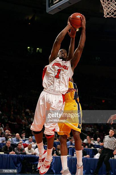 Terrence Williams of the Louisville Cardinals goes to the hoop against the West Virginia Mountaineers during the quarterfinals of the Big East...
