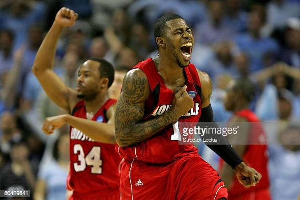 Terrence Williams of the Louisville Cardinals reacts in the second half as does teammate Jerry Smith against the North Carolina Tar Heels during the...