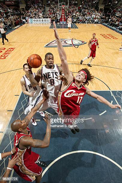 Terrence Williams of the New Jersey Nets goes up for a shot against Jawad Williams and Anderson Varejao of the Cleveland Cavaliers during the game at...