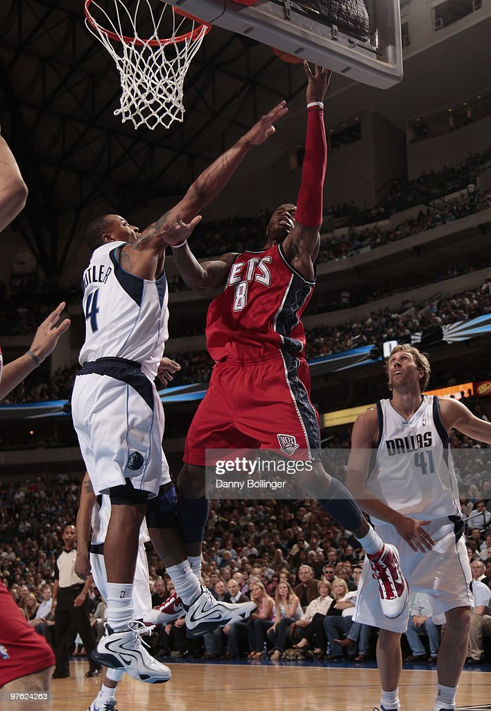 Terrence Williams #8 of the New Jersey Nets goes up for the layup against Caron Butler #4 of the Dallas Mavericks during a game at the American Airlines Center on March 10, 2010 in Dallas, Texas.