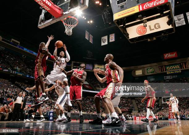 Terrence Williams of the New Jersey Nets shoots against Antawn Jamison of the Cleveland Cavaliers on March 3 2010 at the IZOD Center in East...