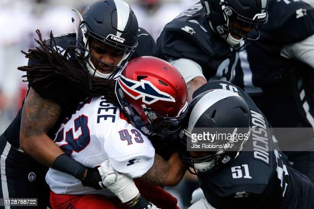 Terrence Magee of Memphis Express is brought down by Xzavier Dickson of Birmingham Iron during an Alliance of American Football game at Legion Field...
