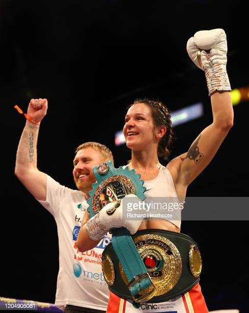 Terri Harper celebrates with the WBC and IBO SuperFeatherweight World Title belts and her trainer Stefy Bull after the WBC and IBO SuperFeatherweight...