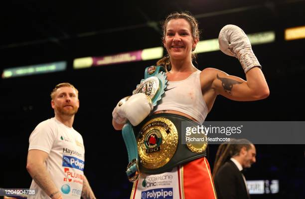 Terri Harper poses with the WBC and IBO SuperFeatherweight World Title belts as Stefy Bull Trainer of Terri Harper looks on after the WBC and IBO...