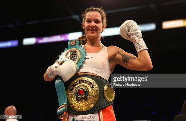 Terri Harper poses with the WBC and IBO SuperFeatherweight World Title belts after the WBC and IBO SuperFeatherweight World Title Fight between Eva...