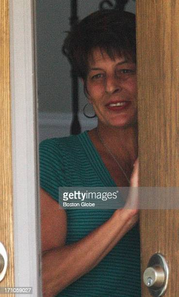 Terri Hernandez, mother of New England Patriots player Aaron Hernandez, answered the door during a fruit delivery at his home in North Attleborough,...