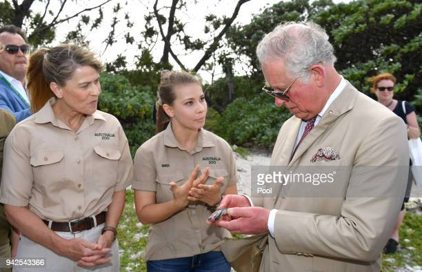 Terri Irwin and Bindi Irwin speak with Prince Charles Prince of Wales before a roundtable meeting discussing coral resilience on Lady Elliot Island...