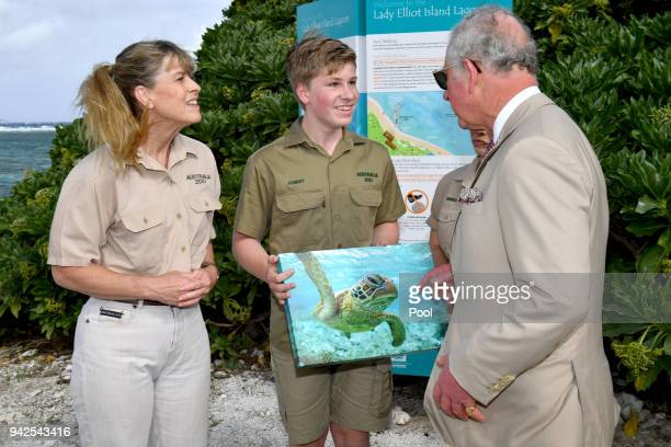 Terri Irwin and Bob Irwin speak with Prince Charles Prince of Wales before a roundtable meeting discussing coral resilience on Lady Elliot Island on...