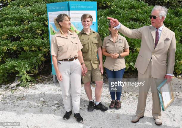 Terri Irwin Bob Irwin and Bindi Irwin speak with Prince Charles Prince of Wales before a roundtable meeting discussing coral resilience on Lady...