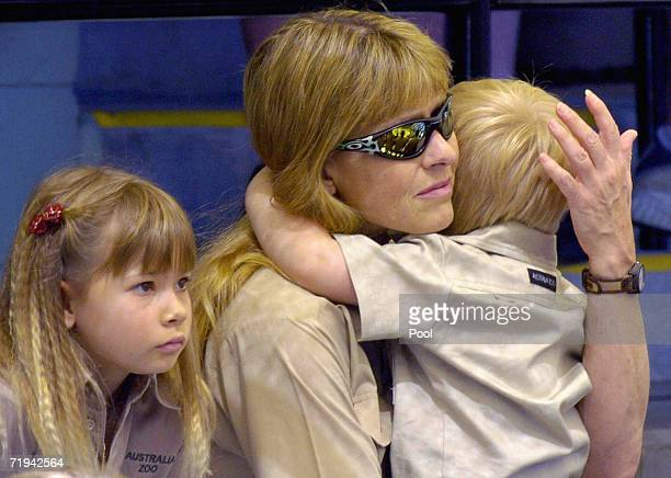 Terri Irwin wife of Australian environmentalist and television personality Steve Irwin sits with daughter Bindi son Bob at the Steve Irwin memorial...