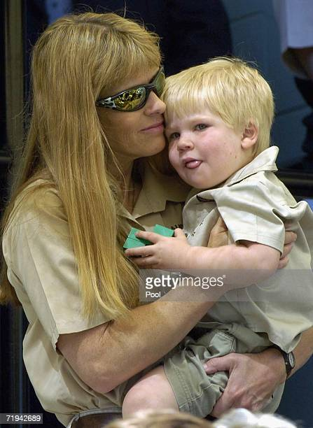 Terri Irwin wife of Australian environmentalist and television personality Steve Irwin holds her son Bob as they attend a memorial service for her...