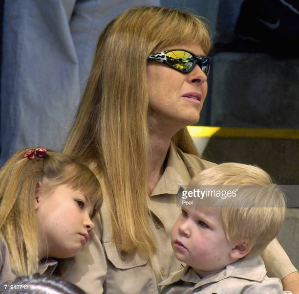 Terri Irwin, wife of Australian environmentalist and television personality Steve Irwin sits with her daughter Bindi and son Bob as they attend a...