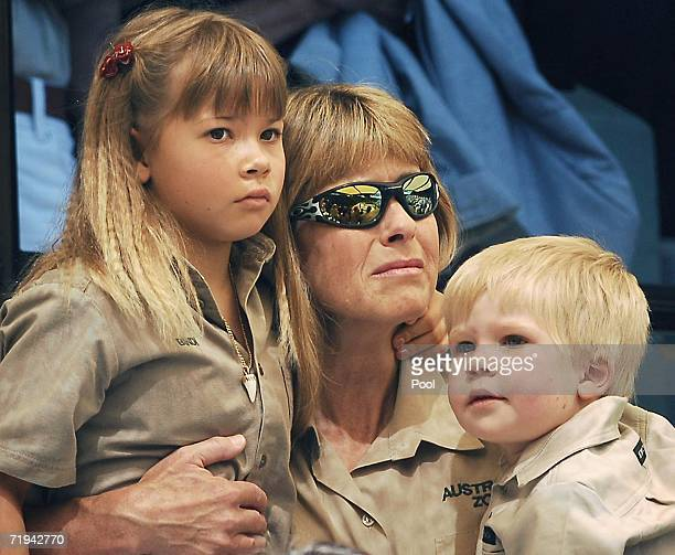 Terri Irwin wife of Australian environmentalist and television personality Steve Irwin holds her daughter Bindi and son Bob as they attend a memorial...