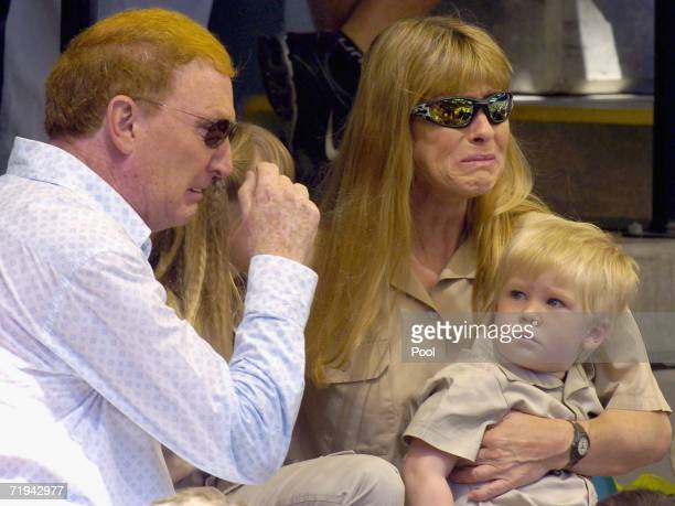 Terri Irwin wife of Australian environmentalist and television personality Steve Irwin sits with son Bob and manager John Stainton at a memorial...