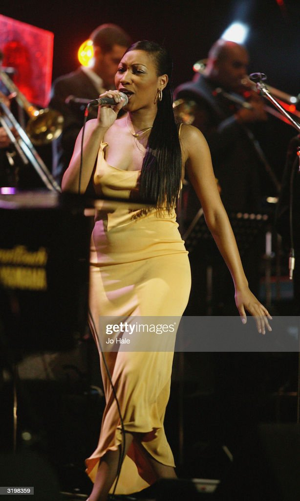 Terri Walker performs on stage with Jools Holland during the