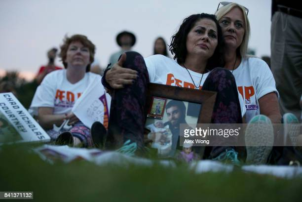 Terri Zaccone of New Port Richey Florida is comforted by sister Tina Rhatigan as she holds a picture of her son Thomas DeVito who has passed away...