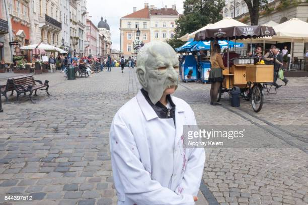 terrible masked man on the rynok square - frankenstein imagens e fotografias de stock